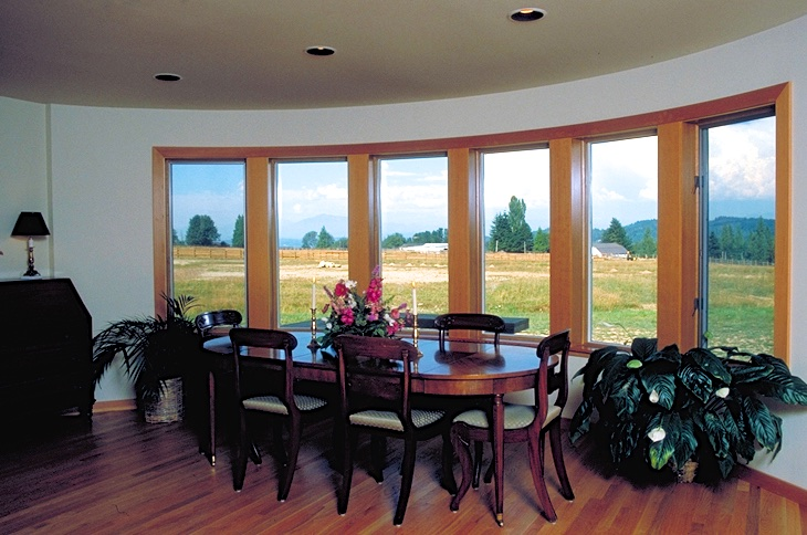 Wood Casement and Picture Windows Mulled Together in Round Walled Room