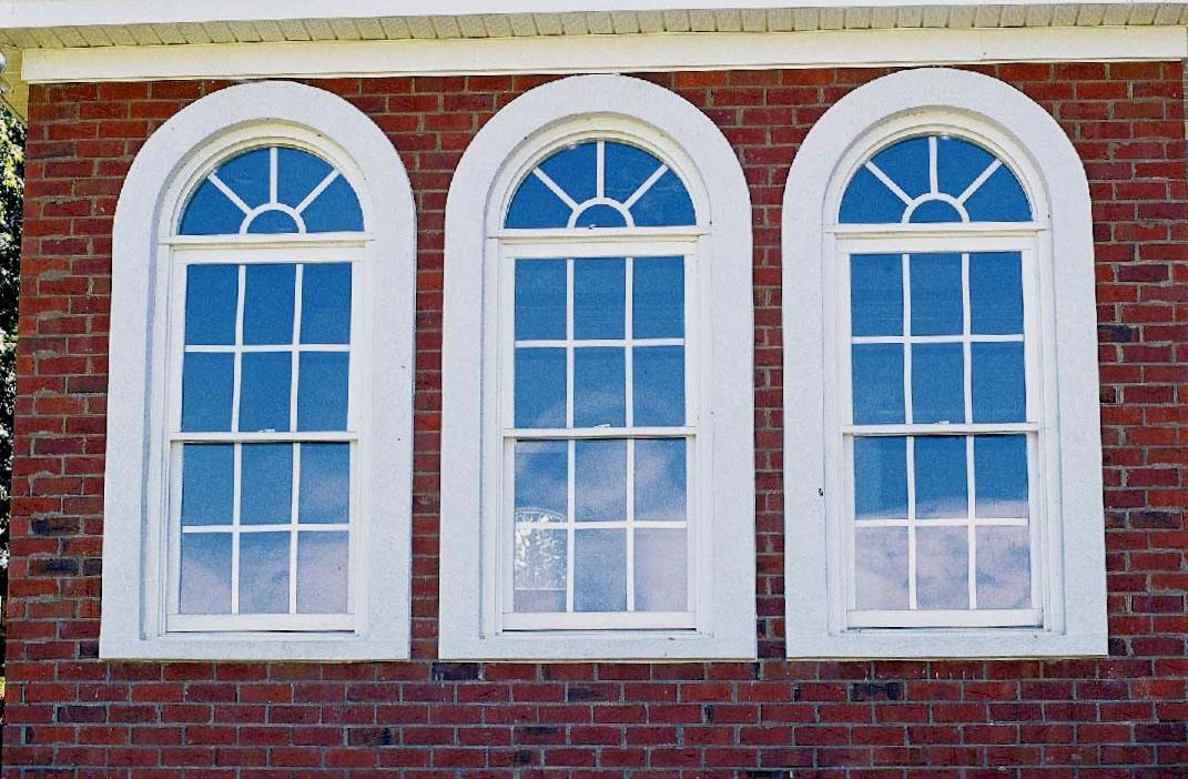 Half Round Windows w/ Sunburst Grids Over Double Hungs