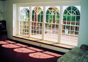 Circle Top w/ SunStar Grids Built into Top Sashes of Windows